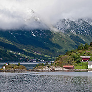 Three weeks aboard the Kong Harald. Hurtigruten, the Coastal Express. Small Houses traditionnaly built on the norwegian coast.