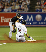 Justin Tyner slides into second base as the ball sails past Tadahito Iguchi during the May 2007 game at the Metrodome.