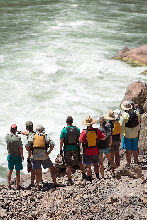 River runners scouting Lava Falls, one of the largest rapids on the Colorado River in the Grand Canyon, Arizona.