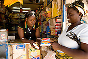 Woman buying iodized salt from a store. Northern Ghana, Thursday November 13, 2008.