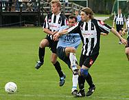 FODBOLD: Bjørn Holm (Helsingør) bremses under kampen i Kvalifikationsrækken, pulje 1, mellem B.1903 og Elite 3000 Helsingør den 27. maj 2006 på B.1903's anlæg. Foto: Claus Birch