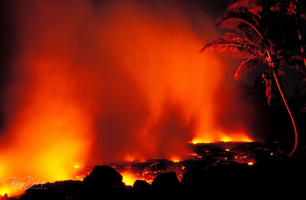 Lava flow entering the Pacific Ocean at night, Kalapana, The Big Island, Hawaii