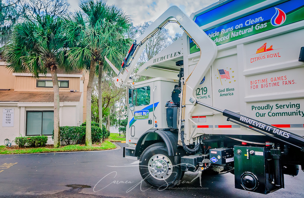 "A Waste Pro Mack Titan collects garbage in the La Vista community, March 18, 2016, in Sanford, Florida. Waste Pro offers waste and recycling services to more than two million residential customers and more than 40,000 businesses in Alabama, Florida, Georgia, South and North Carolina, Louisiana, Mississippi, and Tennessee. The company has committed to ""going green"" by implementing a number of green initiatives, including using CNG (Clean Natural Gas) in its trucks, recycling more waste instead of sending it to landfills, and powering its regional headquarters through solar energy. (Photo by Carmen K. Sisson/Cloudybright)"