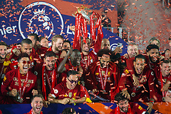 LIVERPOOL, ENGLAND - Wednesday, July 22, 2020: Liverpool's captain Jordan Henderson (C) lifts the Premier League trophy as the Reds are crowned Champions after the FA Premier League match between Liverpool FC and Chelsea FC at Anfield. The game was played behind closed doors due to the UK government's social distancing laws during the Coronavirus COVID-19 Pandemic. Roberto Firmino, Joel Matip,, goalkeeper Caoimhin Kelleher, Dejan Lovren, Naby Keita, captain Jordan Henderson, Mohamed Salah, Virgil van Dijk,, Joe Gomez. (Pic by David Rawcliffe/Propaganda)