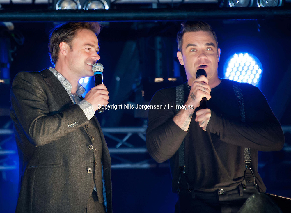 (LtoR) Jamie Theakston with Robbie Williams, during the Marmite Oxford Street Christmas Lights switch-on.  Robbie Williams switches on this year's Christmas lights on the London High Street, hosted by House of Fraser with support from Lewis and boyband Lawson. Theakston and Bunton from Heart 106.2 present, Oxford Street, London, United Kingdom., Oxford Street, London, United Kingdom, November 5, 2012. Photo by Nils Jorgensen / i - Images.