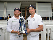 Captain Alastair Cook (right) and Jonny Bairstow (Man of the Match & England Player of the Series) with the Investec Series Trophy after the third and final Investec Test Match between England and Sri Lanka at Lord's. Photo: Graham Morris/ www.photosport.nz