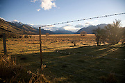 A barbed wire fence runs along the Tasman Valley with Mt Cook in the background.