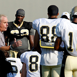 July 29, 2012; Metairie, LA, USA; New Orleans Saints assistant head coach and linebackers coach Joe Vitt huddles up with his players during a training camp practice at the team's practice facility. Mandatory Credit: Derick E. Hingle-US PRESSWIRE