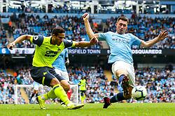 Ramadan Sobhi of Huddersfield Town crosses the ball past Aymeric Laporte of Manchester City - Mandatory by-line: Robbie Stephenson/JMP - 19/08/2018 - FOOTBALL - Etihad Stadium - Manchester, England - Manchester City v Huddersfield Town - Premier League