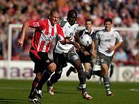 Photo: Daniel Hambury.<br />Brentford v Bristol City. Coca Cola League 1. 07/10/2006.<br />Brentford's Matt Heywood (L) and Bristol City's Enoch Showunmi battle.