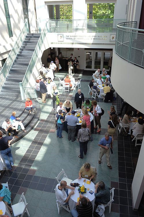 Members of the Alumni College have lunch in the Rockwell Hall Atrium during a fashion class.