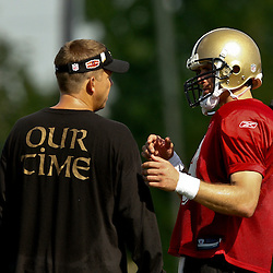 August 1, 2010; Metairie, LA, USA; New Orleans Saints quarterback Drew Brees (9) talks with head coach Sean Payton during a training camp practice at the New Orleans Saints practice facility. Mandatory Credit: Derick E. Hingle