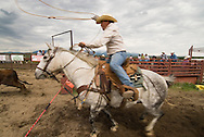 Team roping competition at rodeo in Wilsall Montana