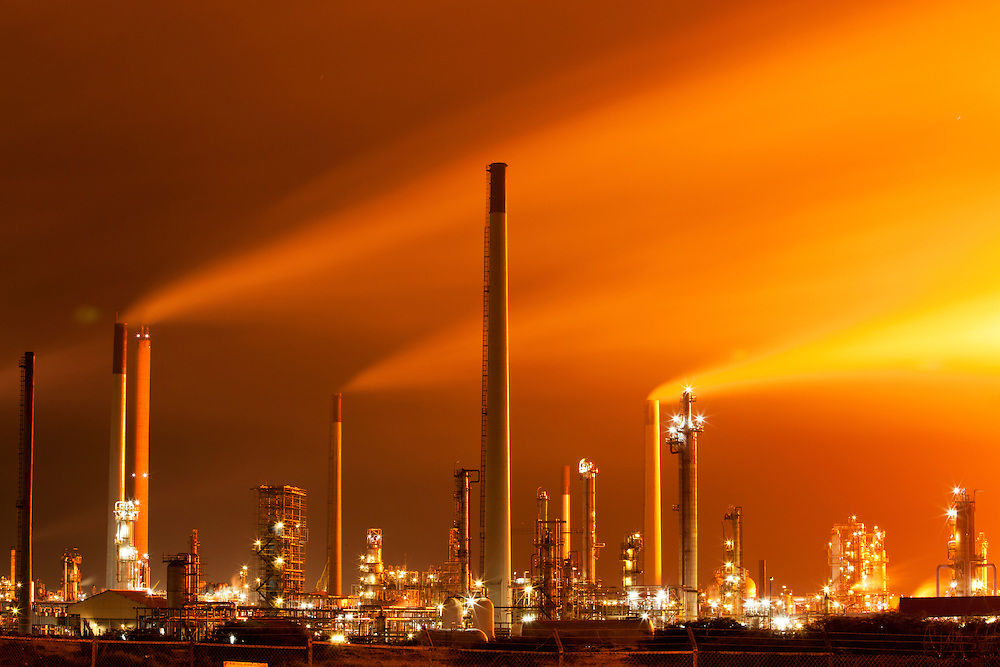 Dutch Antilles, Curacao, Smoke and air pollution billow from glowing Venezuela-owned Isla Oil Refinery at night
