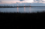 The sun sets on Barataria Bay on March 5, 2011 in Grand Isle, La. The island was heavily impacted by the Deepwater Horizon oil spill April 20, 2010 and continues to recover. (Photo by Carmen K. Sisson/Cloudybright)