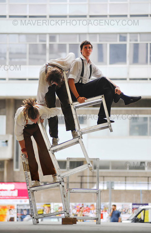Performers from the Controlled Falling Project show off their amazing skills by balancing three chairs on top of each other.  Following sell-out seasons across Australia and Europe, the acrobatics bring their audacious, heart stopping circus skills to Edinburgh for their UK Premiere at the Edinburgh Festival.