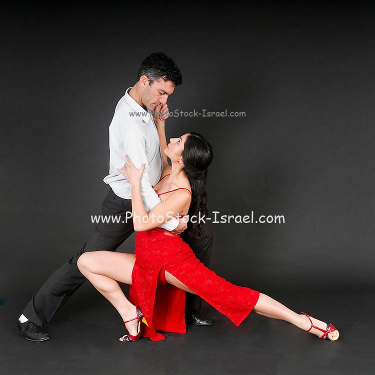 Couple dances tango On black Background