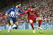 Liverpool defender Andrew Robertson (26) fends off the challenge from Brighton and Hove Albion midfielder Davy Propper (24) during the Premier League match between Liverpool and Brighton and Hove Albion at Anfield, Liverpool, England on 30 November 2019.
