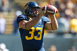 BERKELEY, CA - SEPTEMBER 08: Fullback Tanner Mohr #33 of the California Golden Bears warms up before the game against the Southern Utah Thunderbirds at Memorial Stadium on September 8, 2012 in Berkeley, California. The California Golden Bears defeated the Southern Utah Thunderbirds 50-31. (Photo by Jason O. Watson/Getty Images) *** Local Caption *** Tanner Mohr
