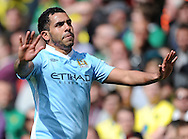 Picture by Andrew Timms/Focus Images Ltd. 07917 236526.14/04/12.Carlos Tevez of Manchester City celebrates scoring his third goal during the Barclays Premier League match against Norwich City at Carrow Road stadium, Norwich.