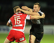 Graeme Horne (15) of Hull Kingston Rovers tackles Liam Watts of Hull Football Club during the First Utility Super League match at Craven Park, Hull<br /> Picture by Richard Gould/Focus Images Ltd +44 7855 403186<br /> 17/04/2014