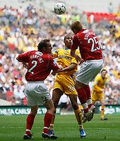 Photo: Steve Bond/Richard Lane Photography. <br />Ebbsfleet United v Torquay United. The FA Carlsberg Trophy Final. 10/05/2008. Michael Bostwick (R) gets a header in in front of Peter Hawkins (L) and Chris Zebroski (C)