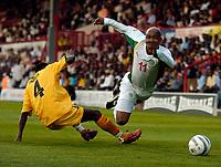 Picture: Henry Browne.<br /> Date: 17/08/2005.<br /> Senegal v Ghana International Friendly at Griffin Park, Brentford, London.<br /> El HadjDiouf of Senegal is fouled by John Pantsil of Ghana.
