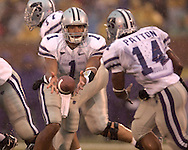 Kansas State quarterback Josh Freeman (1) pitches the ball back to running back Leon Patton (14) against Missouri at Faurot Field in Columbia, Missouri, October 21, 2006.  The Tigers beat the Wildcats 41-21.<br />