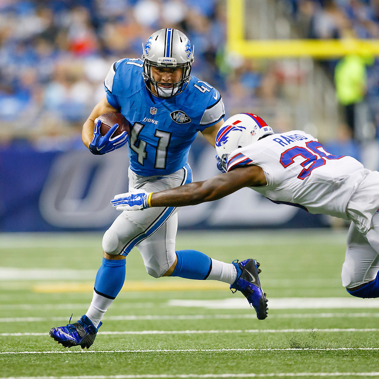 Detroit Lions running back Zach Zenner (41) rushes on Buffalo Bills strong safety Bacarri Rambo (30) during an preseason NFL football game at Ford Field in Detroit, Thursday, Sept. 3, 2015. (AP Photo/Rick Osentoski)