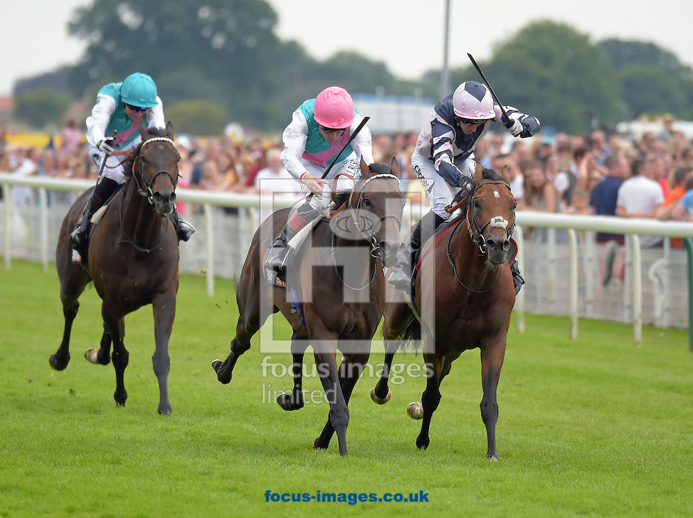 Time Test ridden by Pat Smullen (green with pink sash and white sleeves) wins Sky Bet York Stakes during the Sky Bet York Stakes meeting at York Racecourse, Yorkshire, UK.<br /> Picture by Martin Lynch/Focus Images Ltd 07501333150<br /> 23/07/2016
