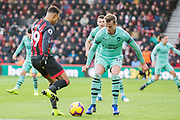 Junior Stanislas (Bournemouth) attempting to get the ball past Rob Holding (Arsenal) during the Premier League match between Bournemouth and Arsenal at the Vitality Stadium, Bournemouth, England on 25 November 2018.