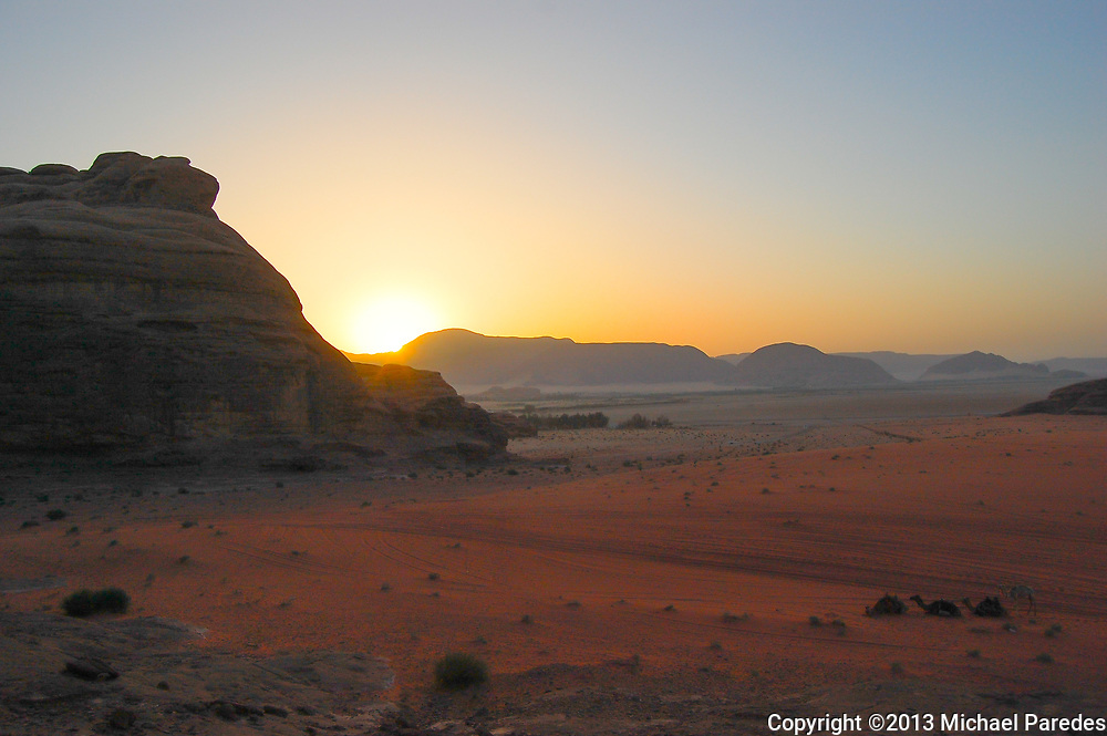 The sun rises over the Jordanian desert of Wadi Rum