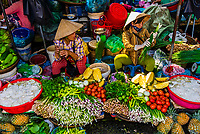 Women selling vegetables in the outdoor market, Hue, Central Vietnam.