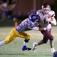 Lauren Wood   Buy at photos.djournal.com<br /> Kossuth's Jaley Adams is tackled by Booneville's Trevin Moore during Friday night's game at Booneville.