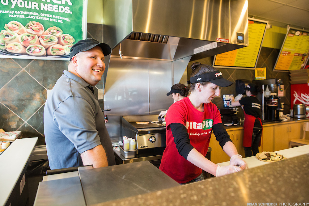 March 13, 2015; Virginia Beach, VA, USA; Small business owners and Navy Federal customers Anthony and Tami Rivera work at their Pita Pit and and Edible Arrangements franchises in Virginia Beach, VA. Mandatory Credit: Brian Schneider-www.ebrianschneider.com