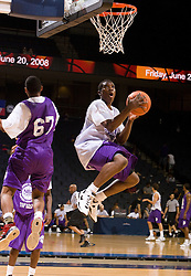 PG Eric Bledsoe (Birmingham , AL / Hayes) blows past G/F Nicos Norris (Mendenhall, MS / Genesis One) to the hoop.  The NBA Player's Association held their annual Top 100 basketball camp at the John Paul Jones Arena on the Grounds of the University of Virginia in Charlottesville, VA on June 20, 2008