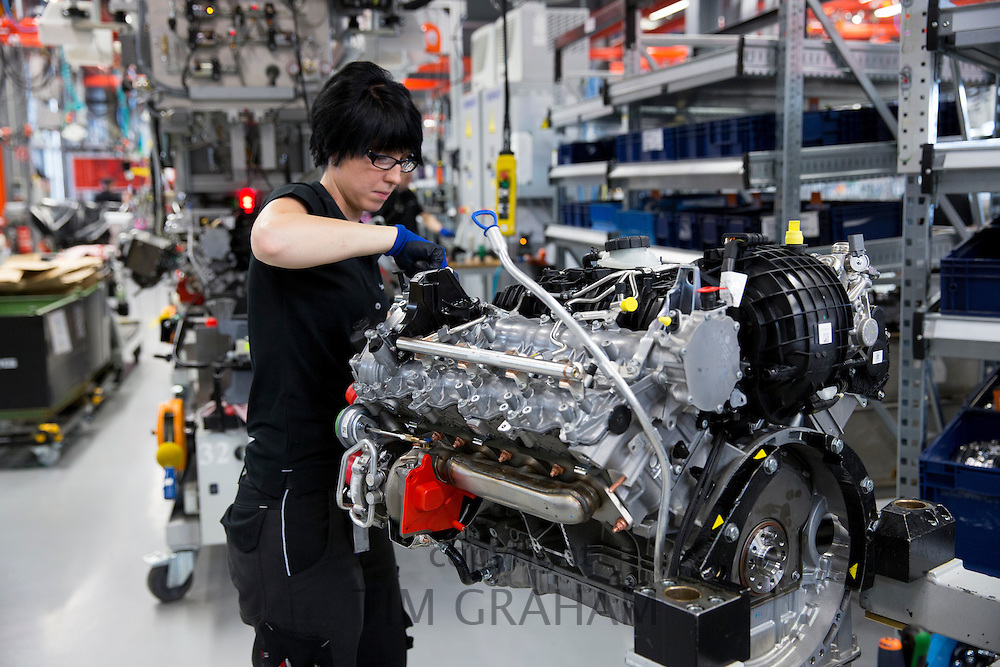 Mercedes-AMG engine production factory in Affalterbach, Germany - female engineer hand-builds a M157 5.5L V8 biturbo engine