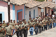 Community Police members armed with shotguns make a parade in the streets of San Luis Acatlán, on February 17th, 2013.  / Policías Comunitarios armados con escopetas desfilan en las calles de San Luis Acatlán el 17 de febrero de 2013. (Photo: Prometeo Lucero)