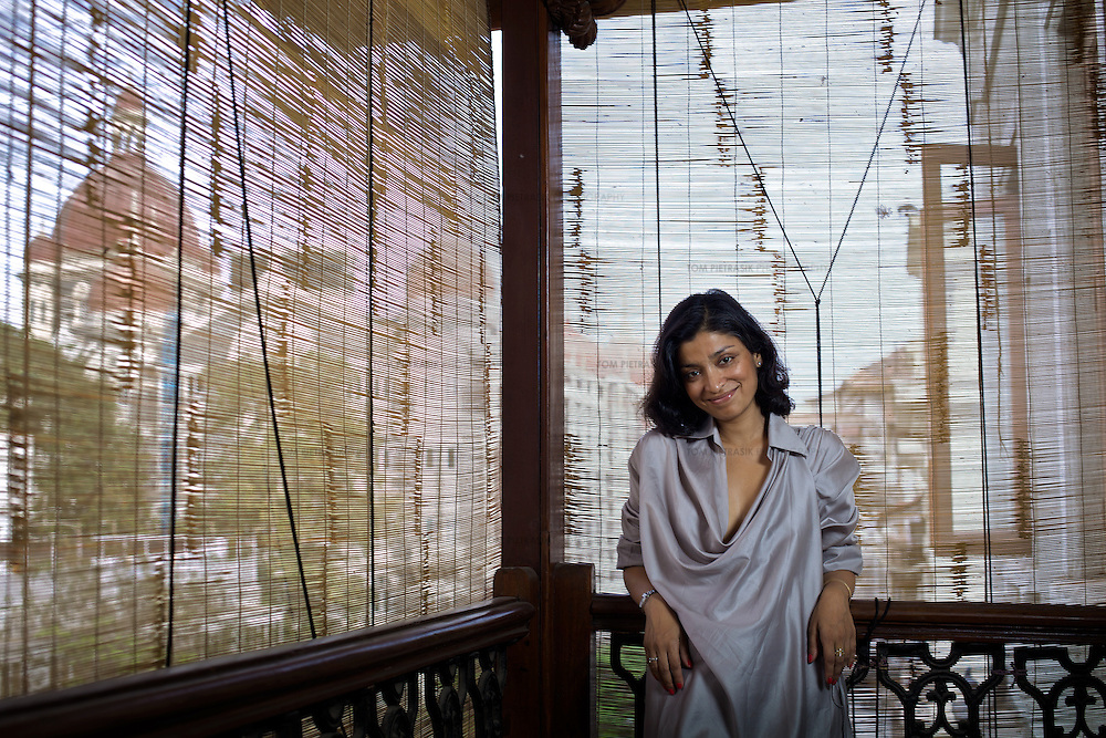 Designer Divya Thakur with a view of the Taj Hotel from the veranda of her recently renovated home on the fourth floor of a century-old building in the Colaba neighbourhood of Mumbai. Thakur runs Design Temple, a graphics firm that she established ten years ago...Photo: Tom Pietrasik.Mumbai, India.February 2010