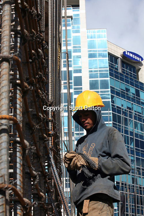 A construction worker works on the top floor of a new office high rise being built in north Bogotá on Friday, May 4, 2007. (Photo/Scott Dalton)