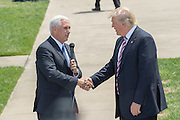 GOP Presidential nominee Donald Trump is greeted by Vice Presidential nominee Indiana Governor Mike Pence as he arrives for the Republican National Convention July 20, 2016 in Cleveland, Ohio. Trump flew into the lakeside airport by his private jet and then by helicopter for a grand arrival.