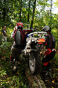 Jason ? (left) and Bill Dragoo (right) balance an R1200GS motorcyle on a log during the team competition at the first annual BMW GS Trophy Challenge held at Spartanburg, SC.