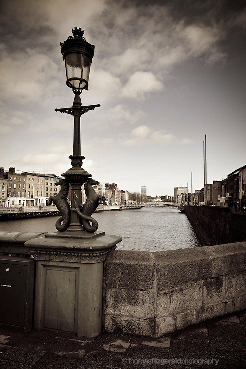 An old statue and lamp post on the River Liffey, Dublin, Ireland