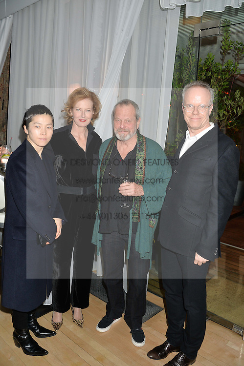 Left to right, KOO JEONG A, JULIA PEYTON-JONES, TERRY GILLIAM and HANS-ULRICH OBRIST at the Liberatum Cultural Honour For Sir Terence Conran Dinner held at the Sanderson Hotel, Berners Street, London on 19th November 2013.