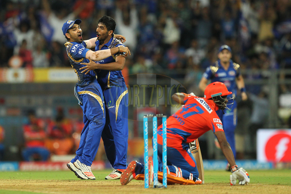 Rohit Sharma captain and Jasprit Bumrah of Mumbai Indians celebrates wicket of Dwayne Bravo of Gujrat Lions  during match 9 of the Vivo Indian Premier League ( IPL ) 2016 between the Mumbai Indians and the Gujarat Lions held at the Wankhede Stadium in Mumbai on the 16th April 2016Photo by Prashant Bhoot/ IPL/ SPORTZPICS