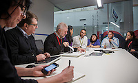 NITV Australian National Indigenous Television Story.<br />  Journalist and presenter Ryan Liddle centre next to left Angela Bates, executive producer and Chief of Staff Michael Carey in morning news conference.