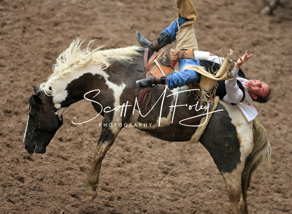 Bareback Rider Tigh Anderberg takes a long ride that included a jump over the media put but finished with an impressive score of 78, 27 July 2007, Cheyenne Frontier Days