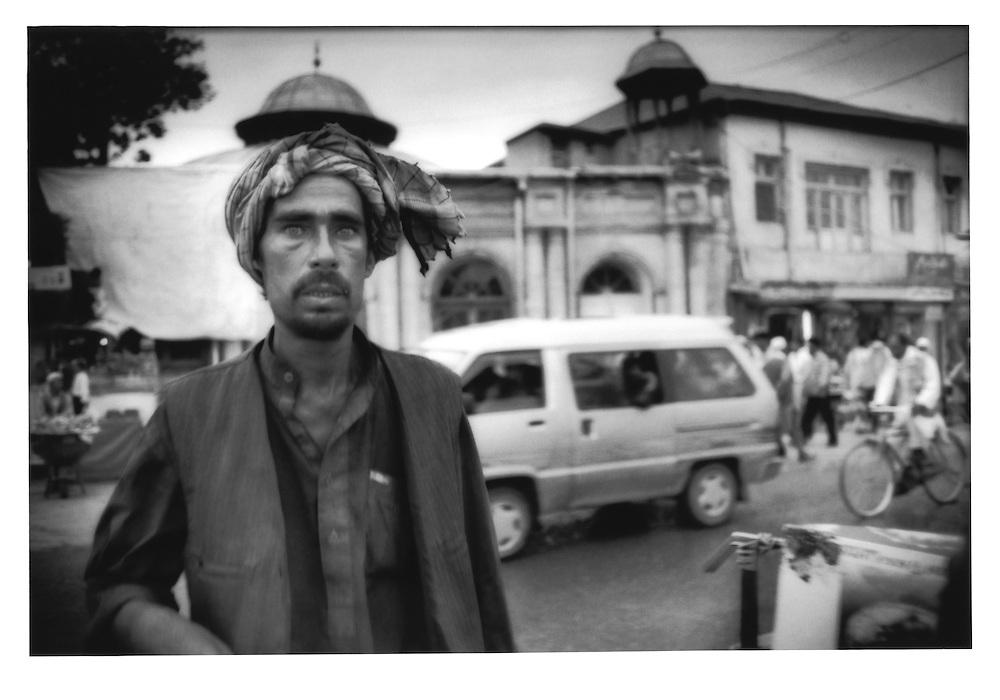 Very wary gaze on a Kabul street, Afghanistan.