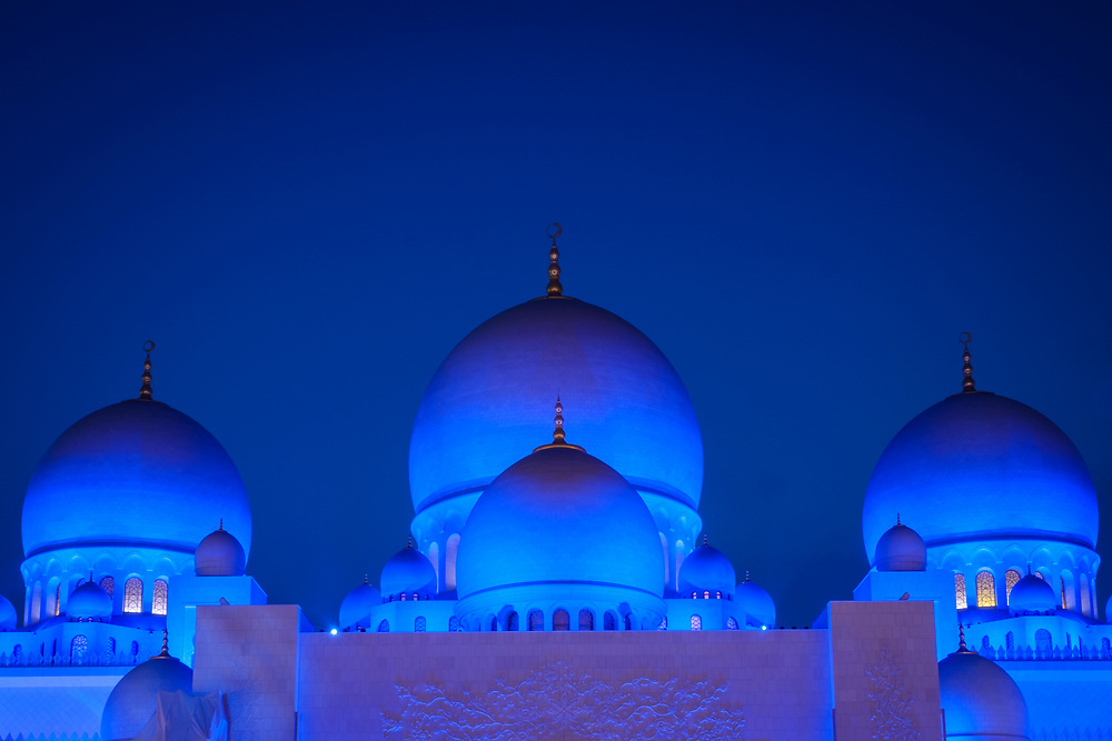 UNITED ARAB EMIRATES, ABU DHABI - CIRCA JANUARY 2017: View of the domes and cupolas at night of the Sheikh Zayed Mosque