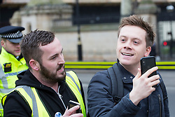 © Licensed to London News Pictures. 07/01/2019. London, UK. Guardian journalist and political activists OWEN JONES is heckled by a group of Brexit supporters, including JAMES GODDARD (pictured left) in Westminster. Photo credit:  George Cracknell/LNP